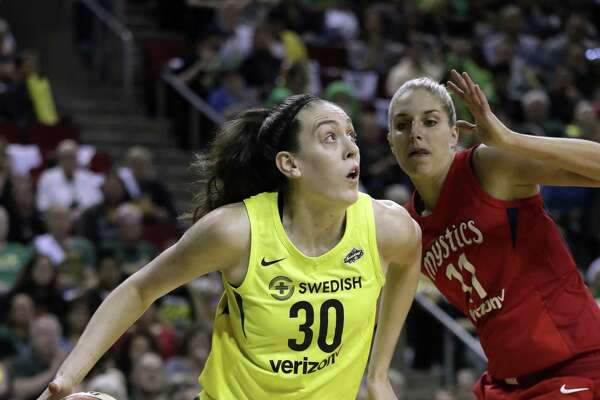 The Seattle Storm's Breanna Stewart drives past the Washington Mystics' Elena Delle Donne during Game 1 of the WNBA Finals on Sept. 7 in Seattle.