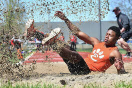Edwardsville long jumper Kenyon Johnson lands after leaping 22-9 to finish second in the event at the Winston Brown Track and Field Invitational.