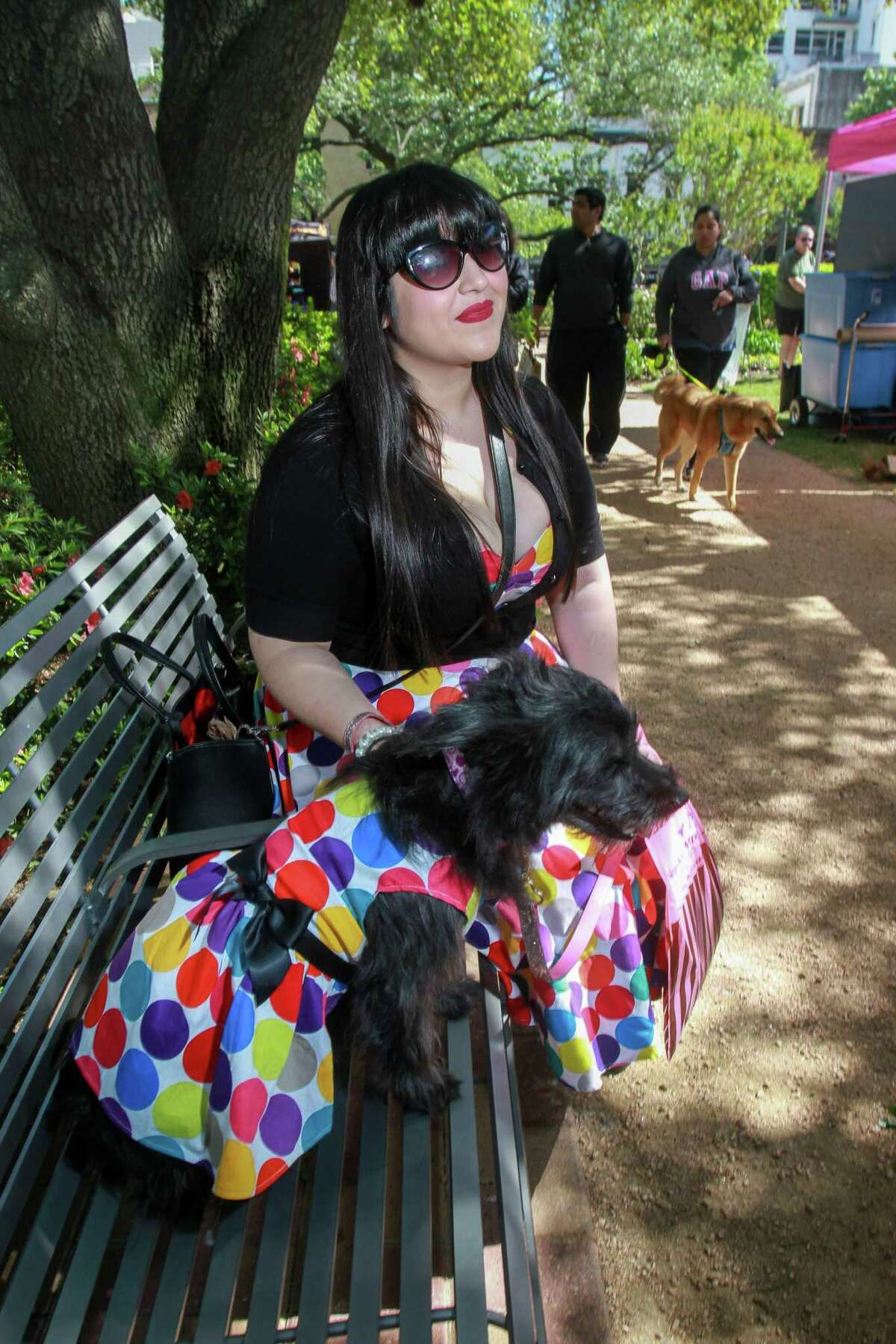 """Leslie Gutierrez with """"Lolita,"""" who Leslie found in a ditch two years ago today, at Puppies for Breakfast, the largest dog festival in Houston."""