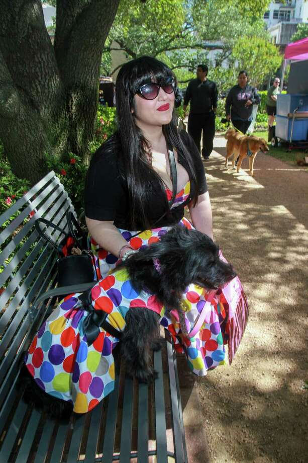 "Leslie Gutierrez with ""Lolita,"" who Leslie found in a ditch two years ago today, at Puppies for Breakfast, the largest dog festival in Houston. Photo: Gary Fountain / Contributor / © 2019 Gary Fountain"