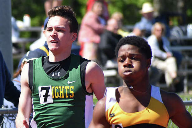 Metro-East Lutheran's Jack Bircher, left, competes in the 200-meter dash.