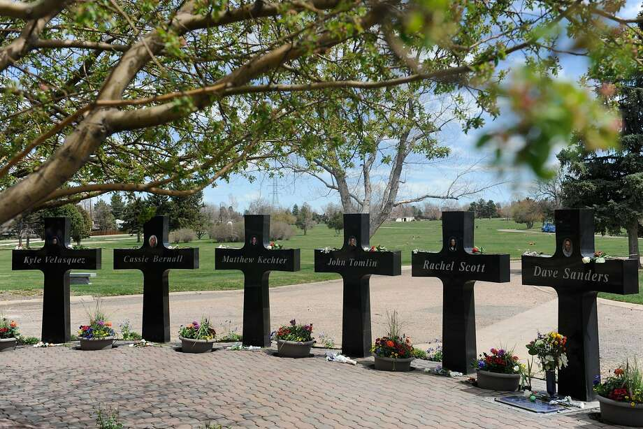 "Crosses with the names and portraits of the victims of the 1999 Columbine High School massacre are seen at the Chapel Hill Memorial Gardens in Littleton, Colorado on April 20, 2019. - It has been 20 years since two heavily armed young men in dark trenchcoats entered a Colorado high school and launched a bloody attack that seared the word ""Columbine"" into the American psyche, forever transforming the debate on gun rights and school violence. (Photo by Jason Connolly / AFP)JASON CONNOLLY/AFP/Getty Images Photo: Jason Connolly, AFP/Getty Images"