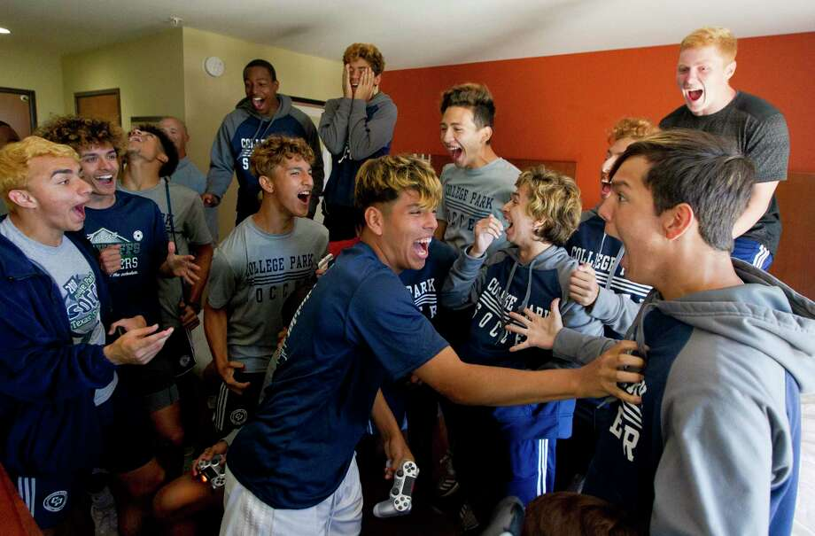 GETTING READY: College Park midfielder Jafet Lara, center, reacts after scoring a goal in a loser-out style FIFA video game tournament in the team's hotel prior to game prepration. Photo: Jason Fochtman, Houston Chronicle / Staff Photographer / © 2019 Houston Chronicle