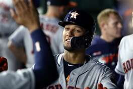 ARLINGTON, TEXAS - APRIL 19: Yuli Gurriel #10 of the Houston Astros celebrates a run against the Texas Rangers in the fifth inning at Globe Life Park in Arlington on April 19, 2019 in Arlington, Texas. (Photo by Ronald Martinez/Getty Images)