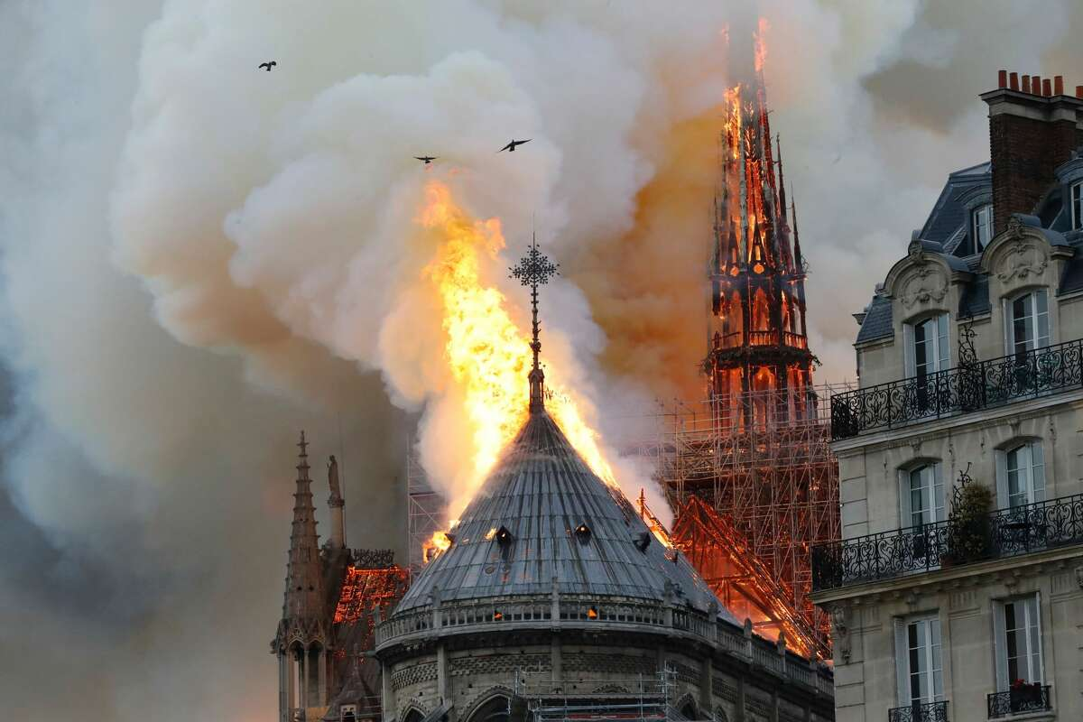 TOPSHOT - Smoke and flames rise during a fire at the landmark Notre-Dame Cathedral in central Paris on April 15, 2019, potentially involving renovation works being carried out at the site, the fire service said. (Photo by FRANCOIS GUILLOT / AFP) (Photo credit should read FRANCOIS GUILLOT/AFP/Getty Images)