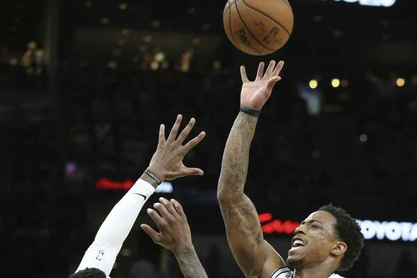 DeMar DeRozan lofts a runner against Torrey Craig as the Spurs host the Nuggets in game 4 of first round Western Conference playoffs at the Alamodome on April 20, 2019.