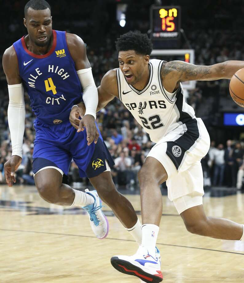 Rudy Gay makes a cut to the lane against Paul Milsap as the Spurs host the Nuggets in game 4 of first round Western Conference playoffs at the Alamodome on April 20, 2019. Photo: Tom Reel/Staff Photographer