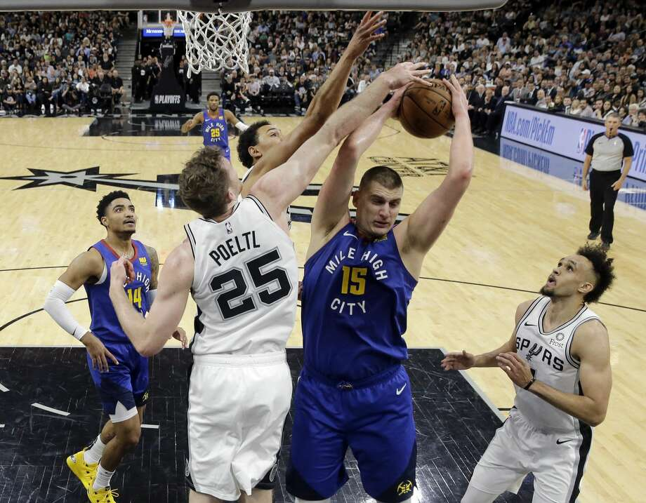Denver Nuggets center Nikola Jokic (15) is defended by San Antonio Spurs center Jakob Poeltl (25) as he tries to score during the first half of Game 4 of an NBA basketball playoff series in San Antonio, Saturday, April 20, 2019. (AP Photo/Eric Gay) Photo: Eric Gay/Associated Press