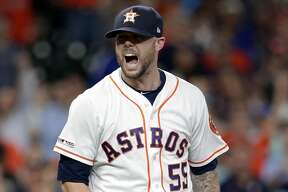Houston Astros relief pitcher Ryan Pressly (55) reacts after striking out New York Yankees catcher Gary Sanchez to end the eighth inning of a baseball game after the New York Yankees scored four runs, Wednesday, April 10, 2019, in Houston. (AP Photo/Michael Wyke)