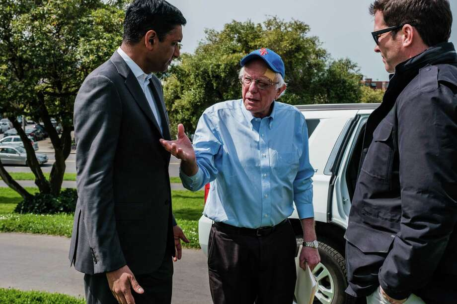 Rep. Ro Khanna, D-Calif., talks to Bernie Sanders before the senator from Vermont takes the stage. In Sanders, Khanna, whose district includes Silicon Valley, found a candidate who shared his diagnosis of the country's most vexing problems: inequality and the failures of unrestrained capitalism. Photo: Photo By Nick Otto For The Washington Post / For The Washington Post