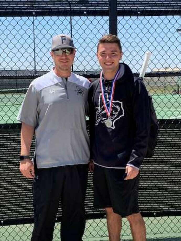 Forsan boys singles player Kobe Richardson, right, wears his silver medal after placing second at the Region I-2A Tennis Tournament to earn a state tournament spot, Thursday in Odessa. Forsan tennis coach Seth Johnson pictured left. Photo: Courtesy Photo