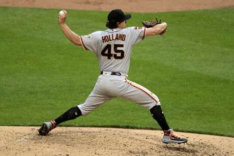 San Francisco Giants starting pitcher Derek Holland delivers in the fifth inning of a baseball game against the Pittsburgh Pirates in Pittsburgh, Saturday, April 20, 2019. (AP Photo/Gene J. Puskar)