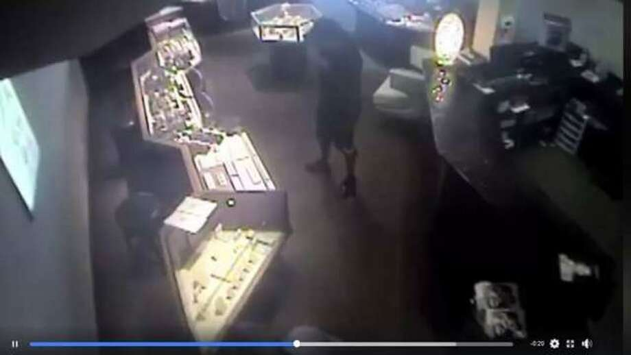 Surveillance image from a theft that took place last July at Hudson Jewelers, located in Edwardsville Crossing off Troy Road.