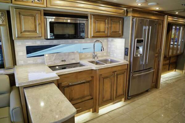 A view of the inside of a Tiffin Phaeton motorhome at Alpin Haus on Tuesday, April 16, 2019, in Amsterdam, N.Y. The motorhome comes with a full size refrigerator along with other amenities. (Paul Buckowski/Times Union)