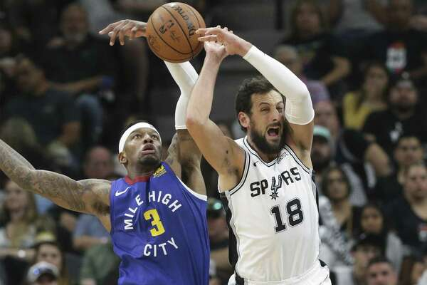 Marco Belinelli has the ball knocked away from behind by Torrey Craig in the second half as the Spurs host the Nuggets in game 4 of first round Western Conference playoffs at the Alamodome on April 20, 2019.