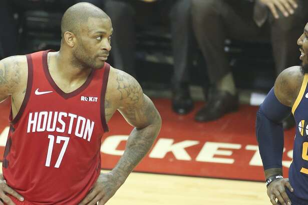 Houston Rockets forward PJ Tucker (17) and Utah Jazz forward Jae Crowder (99) take a look at each other as they line up for a free throw during Game 2 of the NBA game series on Wednesday, April 17, 2019 in Houston. Rockets won the game 118-98 and lead the series 2-0.