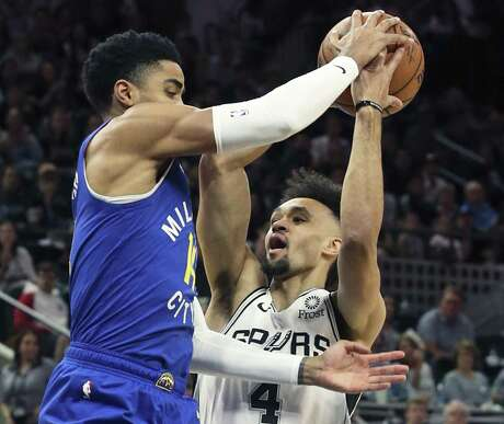 Derrick White is stopped by Gary Harris on the first possession of the game as the Spurs host the Nuggets in game 4 of first round Western Conference playoffs at the Alamodome on April 20, 2019.