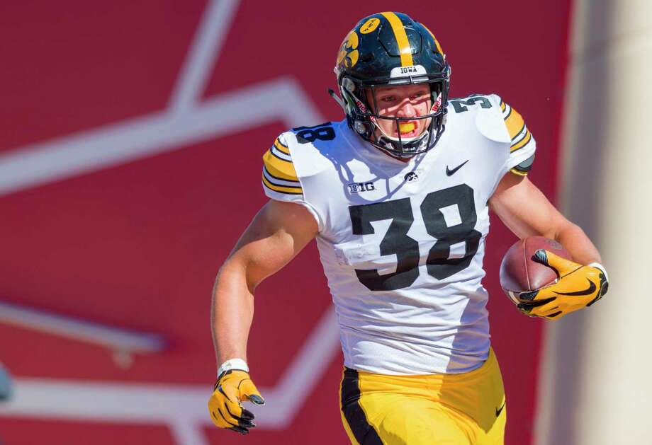 FILE - In this Oct. 13, 2018, file photo, Iowa tight end T.J. Hockenson (38) rushes the ball into the end zone to score during the second half of an NCAA college football game against Indiana, in Bloomington, Ind. Hockenson is a possible pick in the 2019 NFL Draft. (AP Photo/Doug McSchooler, File) Photo: Doug McSchooler / Copyright 2018 The Associated Press. All rights reserved