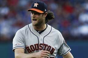 Houston Astros starting pitcher Gerrit Cole reacts after giving up a hit Texas Rangers' Logan Forsythe to score a fourth run during the first inning of a baseball game Saturday, April 20, 2019, in Arlington, Texas. (AP Photo/Mike Stone)