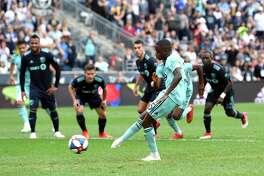 Philadelphia Union's Jamiro Monteiro, scores a goal on a penalty kick past Montreal Impact goalkeeper Evan Bush during the first half of an MLS soccer match, Saturday, April 20, 2019, in Chester, Pa. (AP Photo/Derik Hamilton)