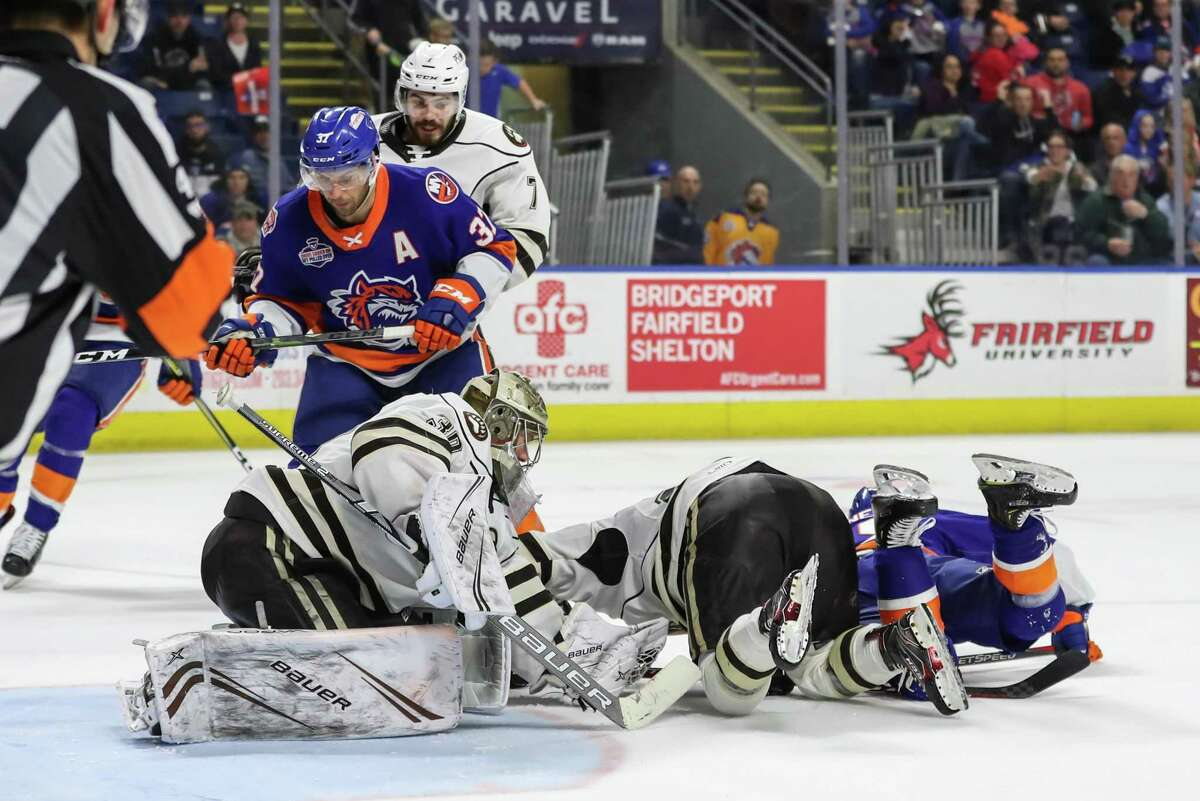 Vitek Venecek (30) covers the puck as Steve Bernier (37) of the Bridgeport Sound Tigers waits for a rebound during game two of the first round of the AHL Calder Cup Playoffs between the Bridgeport Sound Tigers and the Hershey Bears on April 20, 2019 at Webster Bank Arena in Bridgeport, CT.
