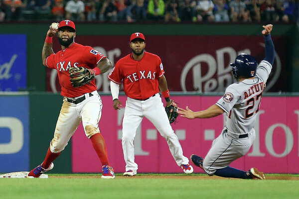 ARLINGTON, TEXAS - APRIL 20: Danny Santana #38 of the Texas Rangers makes the throw to first after getting the force out of Jose Altuve #27 of the Houston Astros in the fifth inning at Globe Life Park in Arlington on April 20, 2019 in Arlington, Texas. (Photo by Richard Rodriguez/Getty Images)