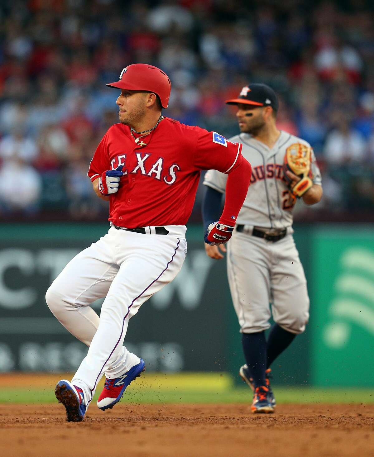 ARLINGTON, TEXAS - APRIL 20: Asdrubal Cabrera #14 of the Texas Rangers stops after advancing to second on a hit in the first inning against the Houston Astros at Globe Life Park in Arlington on April 20, 2019 in Arlington, Texas. (Photo by Richard Rodriguez/Getty Images)