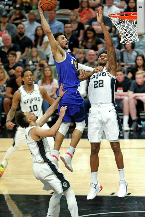 SAN ANTONIO, TX - APRIL 20:  Jamal Murray #27 of the Denver Nuggets scores over Rudy Gay #22 of the San Antonio Spurs during Game Four of the first round of the 2019 NBA Western Conference Playoffs at AT&T Center on April 20, 2019 in San Antonio, Texas.  NOTE TO USER: User expressly acknowledges and agrees that by downloading and or using this photograph, User is consenting to the terms and conditions of the Getty Images License Agreement. (Photo by Ronald Cortes/Getty Images) Photo: Ronald Cortes / 2019 Getty Images