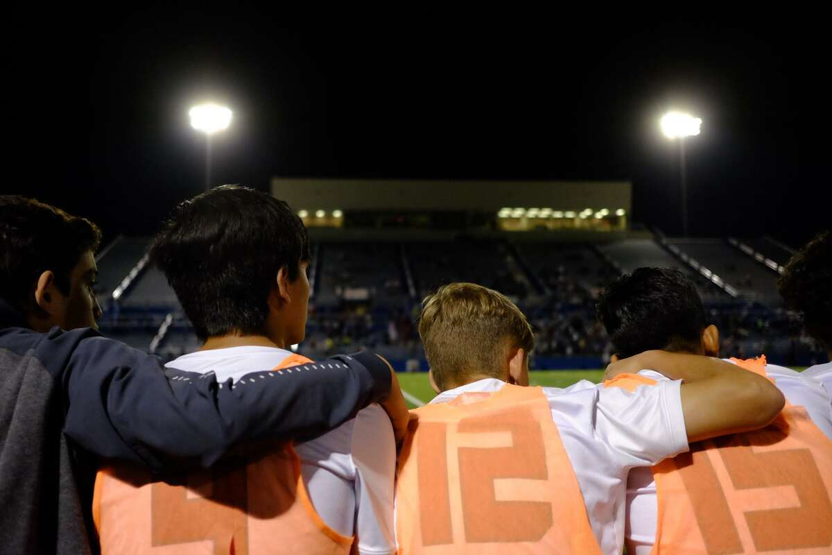 The LEE High School Volunteers bench during a tense moment in the state championship soccer game. [Dimitri Staszewski /San Antonio Express-News]
