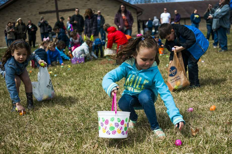 Beverleigh Bentley of Saginaw County, 6, reaches down for an egg during an Easter egg hunt on Saturday, April 20, 2019 at Faith Wesleyan Church. (Katy Kildee/kkildee@mdn.net) Photo: (Katy Kildee/kkildee@mdn.net)