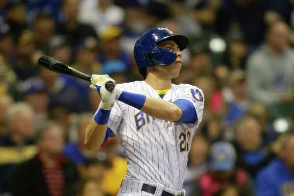 Milwaukee Brewers' Christian Yelich watches his home run against the Los Angeles Dodgers during the sixth inning of a baseball game Saturday, April 20, 2019, in Milwaukee. (AP Photo/Jeffrey Phelps)