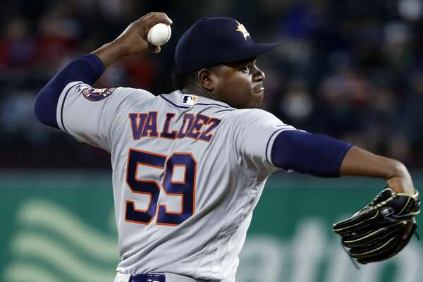 Houston Astros starting pitcher Framber Valdez works against the Texas Rangers during a baseball game in Arlington, Texas, Tuesday, April 2, 2019. (AP Photo/Tony Gutierrez)