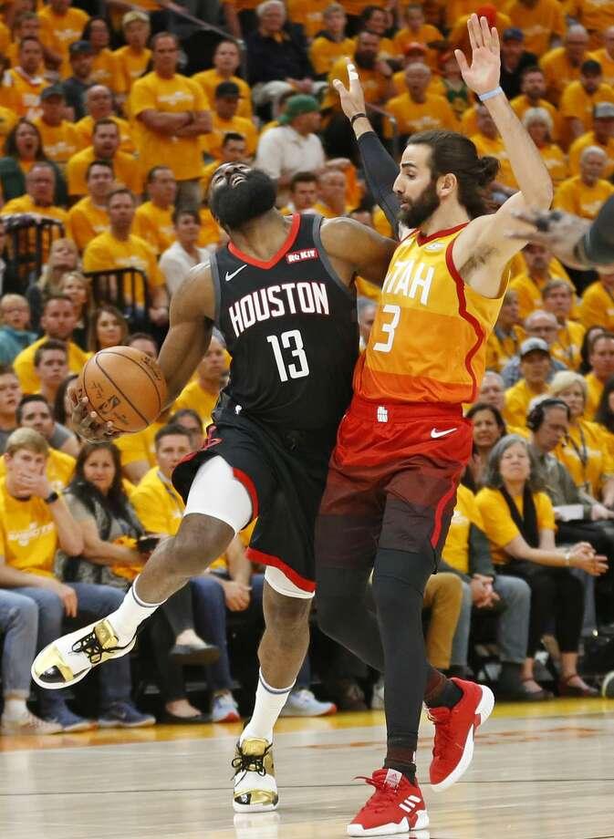 Utah Jazz guard Ricky Rubio (3) fouls Houston Rockets guard James Harden (13) as he drives in the first half during an NBA basketball game Saturday, April 20, 2019, in Salt Lake City. (AP Photo/Rick Bowmer) Photo: Rick Bowmer/Associated Press