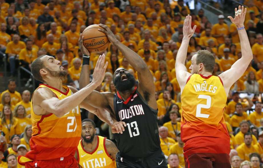 Utah Jazz's Rudy Gobert, left, and Joe Ingles (2) defend against Houston Rockets guard James Harden (13) in the first half during an NBA basketball game Saturday, April 20, 2019, in Salt Lake City. (AP Photo/Rick Bowmer) Photo: Rick Bowmer/Associated Press