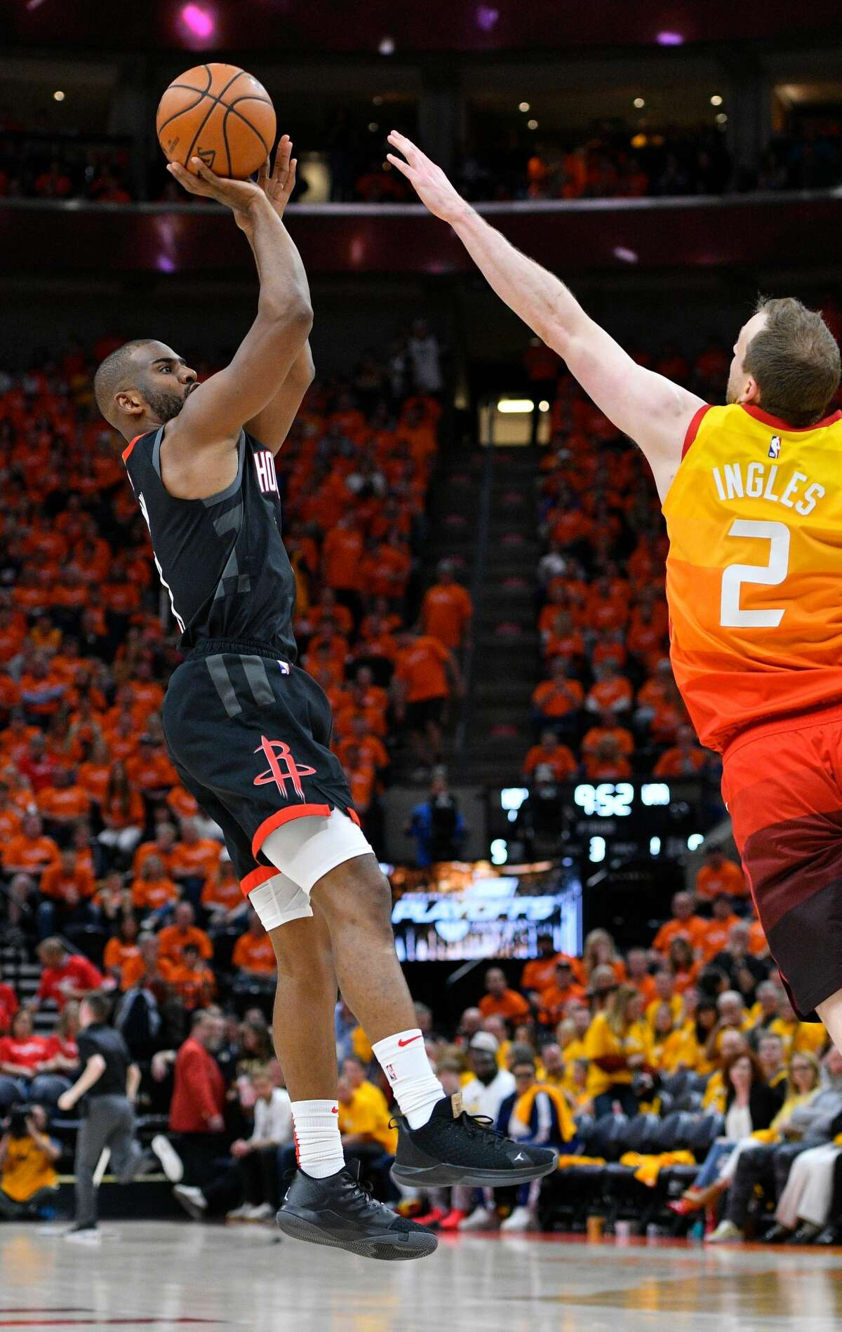 SALT LAKE CITY, UT - APRIL 20: Chris Paul #3 of the Houston Rockets shoots a three point basket over Joe Ingles #2 of the Utah Jazz in the second half of Game Three during the first round of the 2019 NBA Western Conference Playoffs at Vivint Smart Home Arena on April 20, 2019 in Salt Lake City, Utah. NOTE TO USER: User expressly acknowledges and agrees that, by downloading and or using this photograph, User is consenting to the terms and conditions of the Getty Images License Agreement. (Photo by Gene Sweeney Jr./Getty Images)