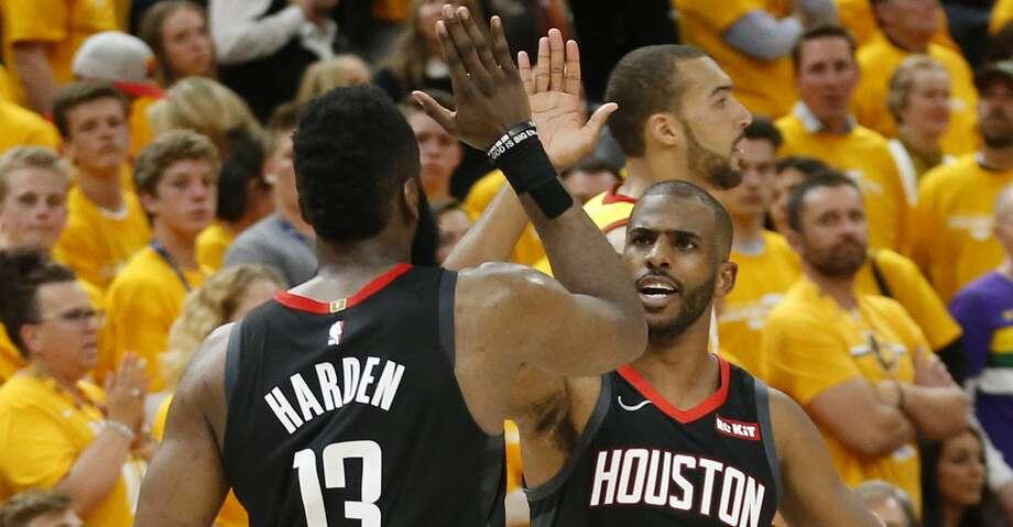 959d32c69ccc Houston Rockets  Chris Paul (3) and James Harden (13) celebrate after