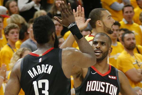 Houston Rockets' Chris Paul (3) and James Harden (13) celebrate after their NBA basketball game against the Utah Jazz Saturday, April 20, 2019, in Salt Lake City. (AP Photo/Rick Bowmer)