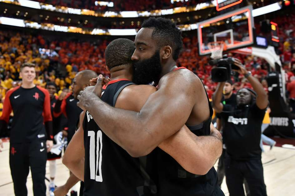 SALT LAKE CITY, UT - APRIL 20: Eric Gordon #10 and James Harden #13 of the Houston Rockets embrace after their 104-101 win over the Utah Jazz in Game Three during the first round of the 2019 NBA Western Conference Playoffs at Vivint Smart Home Arena on April 20, 2019 in Salt Lake City, Utah. NOTE TO USER: User expressly acknowledges and agrees that, by downloading and or using this photograph, User is consenting to the terms and conditions of the Getty Images License Agreement. (Photo by Gene Sweeney Jr./Getty Images)