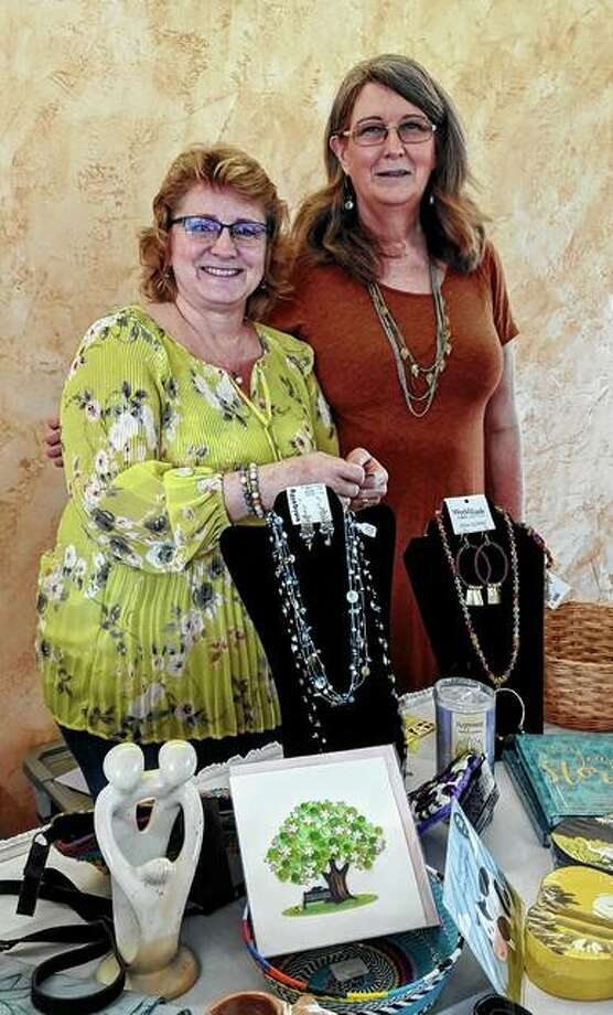 Rhonda Kircher (right) of Just Good Trade was the featured speaker April 6 at the Morgan County Garden Club's spring luncheon at Jacksonville Country Club. She and her assistant, Kelly Hunter, displayed some of the merchandise they carry in the store. Photo: Photo Provided