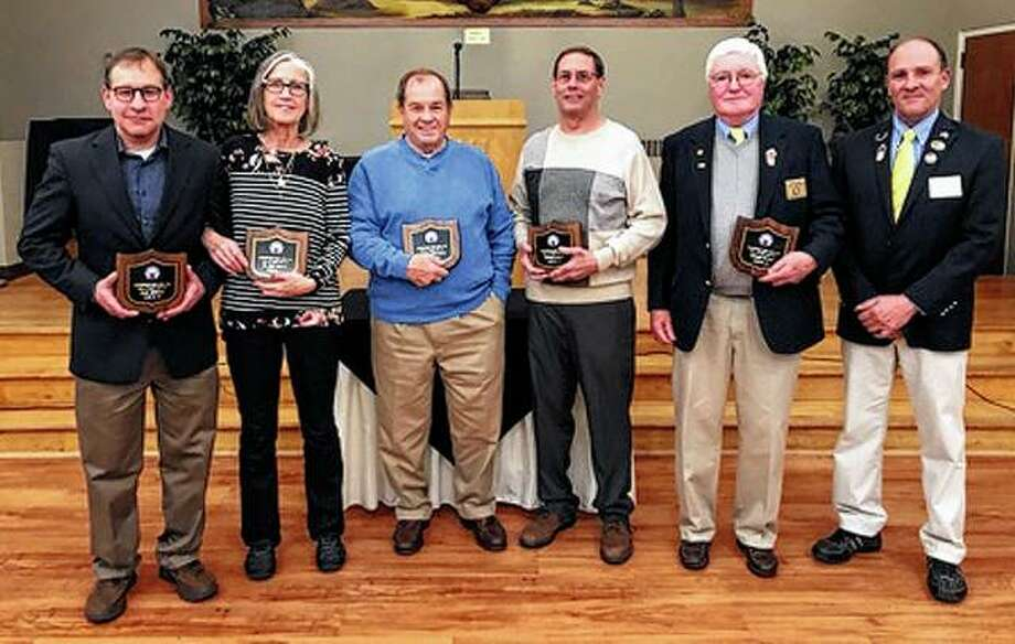 Members of the Elks Hall of Fame 2019 class recently were inducted into the hall. Exalted Ruler Doug Sills (right) presented the honor to Jeff Andrews (from left), accepting on behalf of his father, Dean Andrews; Margaret Wagner, accepting on behalf of her husband, Gary Wagner; Don Schillinger; Mike Elliott and Rich Withee. Photo: Photo Provided