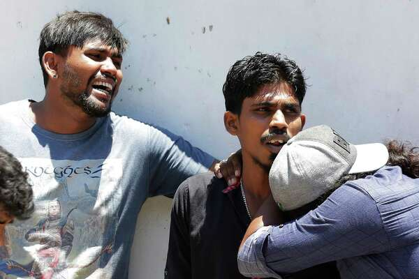 Relatives of people killed in Church blasts mourn as they wait outside mortuary of a hospital in Colombo, Sri Lanka, Sunday, April 21, 2019. Near simultaneous blasts rocked three churches and three hotels in Sri Lanka on Easter Sunday.