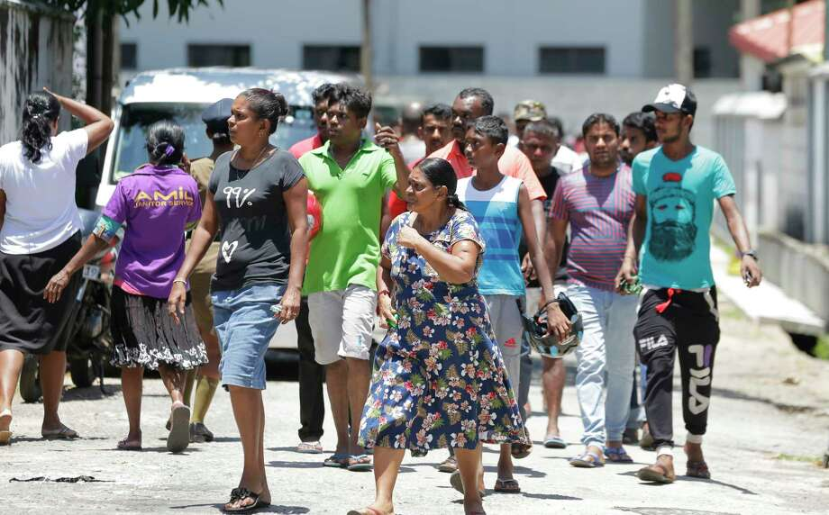 Relatives gather outside a hospital following blasts in Colombo, Sri Lanka, Sunday, April 21, 2019. More than hundred people were killed and hundreds more hospitalized from injuries in near simultaneous blasts that rocked three churches and three luxury hotels in Sri Lanka on Easter Sunday, a security official told The Associated Press, in the biggest violence in the South Asian country since its civil war ended a decade ago. Photo: Eranga Jayawardena, AP / Copyright 2019 The Associated Press. All rights reserved.