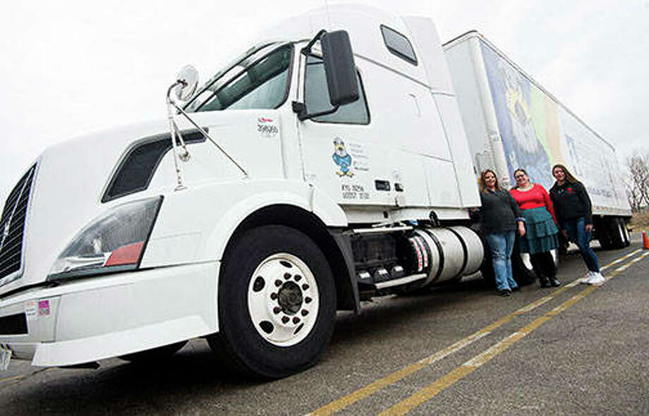 Holli Hays (from left), Daun Greif and Sevin Headley are the latest students to take on Heartland Community College's CDL truck driver training class. Photo: Lewis Marien | The Pantagraph (AP)