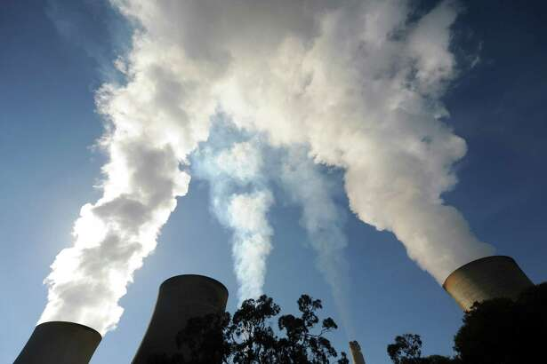 Steam billows from the cooling towers of the Yallourn coal-fired power station in the Latrobe Valley, Australia, on Wednesday, April 29, 2015.