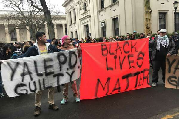Protesters bring signs to a rally protesting police violence against Stephanie Washington, 22.