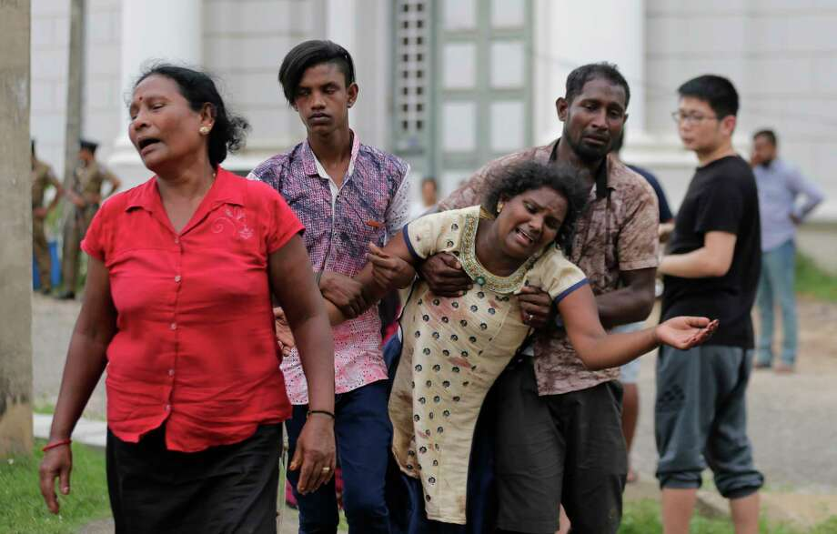 Relatives of a blast victim grieve outside a morgue in Colombo, Sri Lanka, Sunday, April 21, 2019.  More than hundred were killed and hundreds more hospitalized with injuries from eight blasts that rocked churches and hotels in and just outside of Sri Lanka's capital on Easter Sunday, officials said, the worst violence to hit the South Asian country since its civil war ended a decade ago. Photo: Eranga Jayawardena, AP / Copyright 2019 The Associated Press. All rights reserved.
