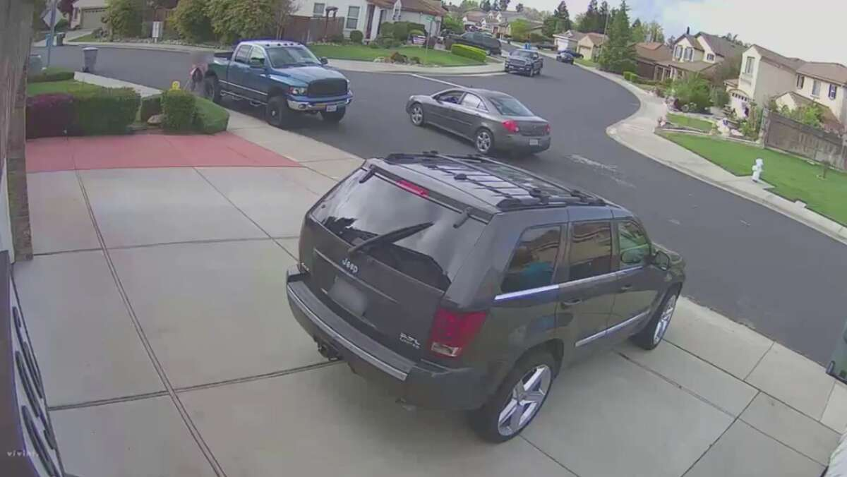 A screenshot from surveillance video released by Vacaville police shows a girl hiding from a suspicious vehicle that circled back several times.