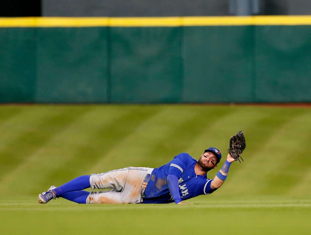 Toronto Blue Jays center fielder Kevin Pillar (11) catches Houston Astros second baseman Jose Altuve's line out during the fourth inning of an MLB game at Minute Maid Park, Wednesday, Aug. 3, 2016, in Houston. ( Karen Warren / Houston Chronicle )