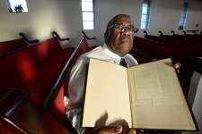 """Rev. Kenneth Lyons sits with the Bible he uses for preaching at Greater New Bethel Baptist Church in Jasper, the church which the Byrd family attended. June 7, 1998, James Byrd, Jr., was murdered after being dragged for miles chained to the back of a pickup truck on Huff Creek Road. John William King, Lawrence Breewer and Shawn Berry were all convicted of Byrd's murder. Brewer was executed in 2011, Berry is serving a life sentence, and King is set to be executed April 24, 2019 in Huntsville. Rev. Lyons' Bible still contains the list of 10 names he wrote out 20 years ago in the wake of Byrd's death. In reference to the Old Testament story of Sodom and Gomorrah, in which Abraham pleads for God to save the city by providing the names of 10 honorable people, Lyons similarly put his faith in God to help Jasper overcome the aftermath of Byrd's murder. He taped his own list to the back of his Bible, where it remains to this day. No one knows the names on that list, he says. """"That's just between me and God."""" Photo taken Tuesday, April 9, 2019 Kim Brent/The Enterprise"""