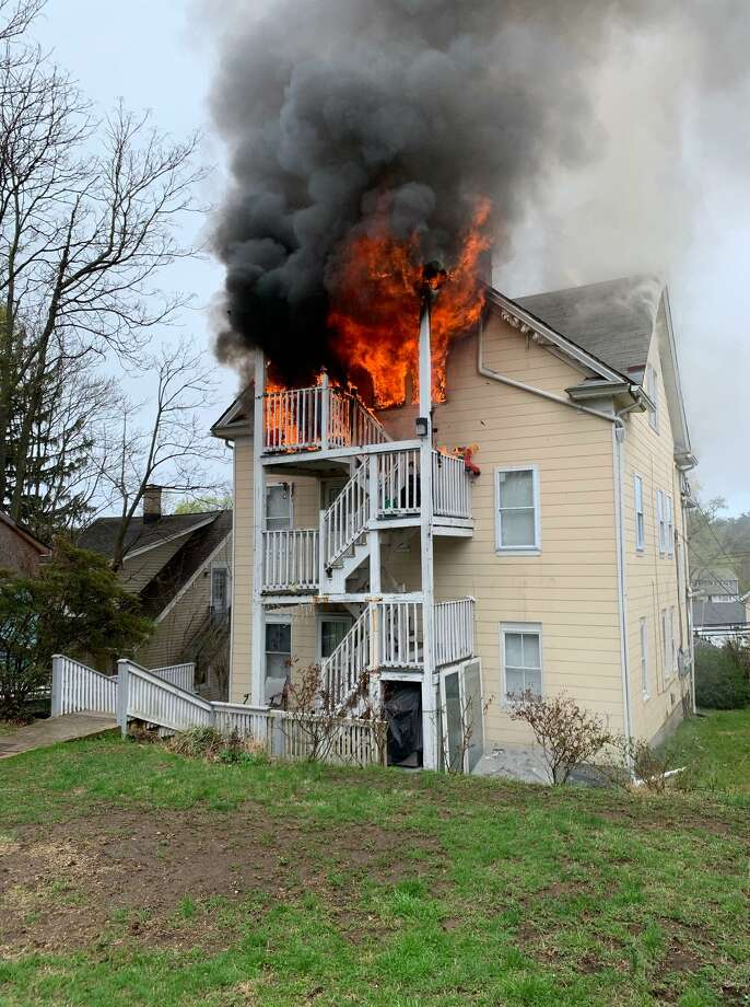 A three-story house on Soundview Avenue in Norwalk was left uninhabitable after a fire on Sunday morning. Photo: / Norwalk Fire Department /Contributed Photo